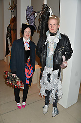 LOUISE GRAY and ED MARLER at a private view of Isabella Blow: Fashion Galore! held at Somerset House, London on 19th November 2013.