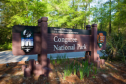The National Park Service welcome sign at the entrance to Congaree National Park, near Columbia, South Carolina on Earth Day, April 20, 2008.  Protected in 1976 by the US Congress as Congaree Swamp National Monument, the 22,000 acre park became Congaree National Park in 2003.  The park is home to primeval forest landscape, champion trees including record bald cypress, tupelo and loblolly pine trees.