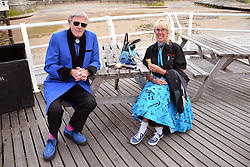 Couple dressed up waiting to see the end of pier show at Cromer, Norfolk UK July 2019