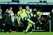 Miguel Almiron (#24) of Newcastle United and Arnaut Danjuma (#14) of AFC Bournemouth battle for the ball during the Premier League match between Newcastle United and Bournemouth at St. James's Park, Newcastle, England on 9 November 2019.