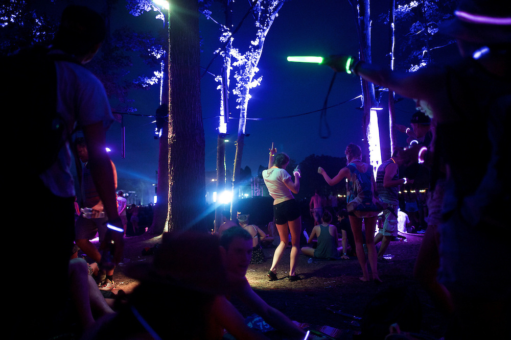 Revelers dance during the Firefly Music Festival in Dover, Delaware June 20, 2015.  According to organizers, attendance exceeded 90,000 for the four day festival, which featured more than 110 acts, and was set in 105 acre grounds of the Dover International Speedway.