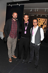 Left to right, JAMIE THEAKESTON, REINIER BOSCH and JONATHAN YEO at the Private View of the Pavilion of Art & Design London 2011 held in Berkeley Square, London on 10th October 2011.