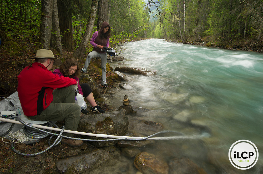 Dr. Peucker-Ehrenbrink's team samples close to the headwaters of the Fraser, Robson River. The bluish color in the water is caused by 'glacial flour', rocks ground up by the glaciers coming off Mount Robson.