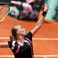 3 June 2009: Svetlana Kuznetsova of Russia serves during the Women's single quarter final match on day eleven of the French Open at Roland Garros in Paris, France.