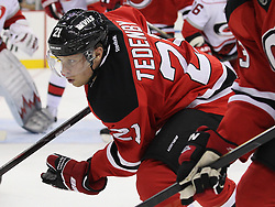 Oct 10; Newark, NJ, USA; New Jersey Devils left wing Mattias Tedenby (21) during the second period at the Prudential Center.