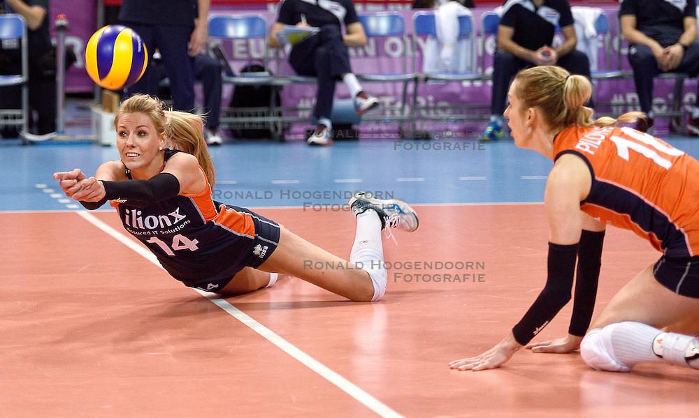 07-01-2016 TUR: European Olympic Qualification Tournament Nederland - Kroatie, Ankara<br /> Nederland verslaat Kroati&euml; met 3-0 en gaat als groepswinnaar de halve finale in / Debby Stam-Pilon #16 kijkt hoe Laura Dijkema #14 de bal bal de grond duikt