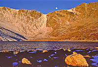 Moon set over Mount Evans massif and Summit Lake.  Front Range Mountains,  Colorado.