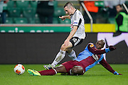 (L) Legia's Michal Kucharczyk fights for the ball with (R) Trabzonspor's Souleymane Bamba during the UEFA Europa League Group J football match between Legia Warsaw and Trabzonspor AS at Pepsi Arena Stadium in Warsaw on November 07, 2013.<br /> <br /> Poland, Warsaw, November 07, 2013<br /> <br /> Picture also available in RAW (NEF) or TIFF format on special request.<br /> <br /> For editorial use only. Any commercial or promotional use requires permission.<br /> <br /> Mandatory credit:<br /> Photo by &copy; Adam Nurkiewicz / Mediasport
