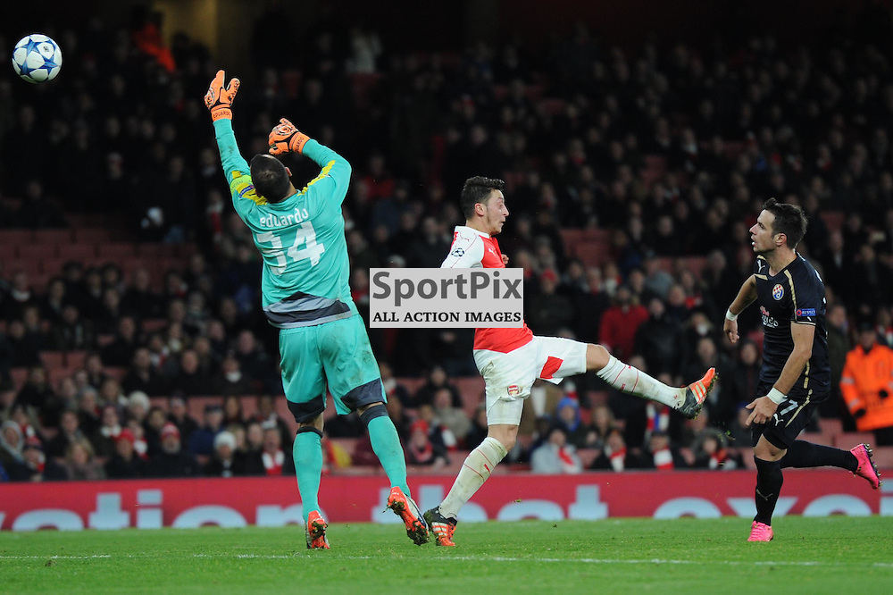 Arsenals Mesut Ozil gets a shot away during the Arsenal v Dinamo Zagreb game in the UEFA Champions League on the 24th November 2015 at the Emirates Stadium.