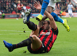 AFC Bournemouth's Steve Cook evades the boots of Brighton & Hove Albion's Gaetan Bong