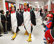Port Jervis High School seniors walk through the halls of Anna S. Kuhl Elementary School during the Halloween Parade, a tradition in Port Jervis, N.Y., for more than 30 years, on Thursday, Oct. 31, 2013. The parade starts with the seniors walking through hallways lined with elementary school students and ends with the elementary school students walking through a line of seniors in front of the high school. (AP Photo/Times Herald-Record/TOM BUSHEY)