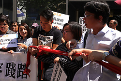 October 6, 2018 - Hong Kong, CHINA - In light of HKSARs refusal to renew working visa for British journalist, Asia Editor of FINANCIAL TIMES and present vice president of Hong Kong FCC, Victor Mallet, Hong Kong citizens staged a protest outside Immigration Department Building this morning, cutting the red cordon in a symbolic gesture to express the base line of universally respected press freedom accusing Hong Kong government of bleaching the commonly shared value. Oct-6,2018 Hong Kong.ZUMA/Liau Chung-ren (Credit Image: © Liau Chung-ren/ZUMA Wire)