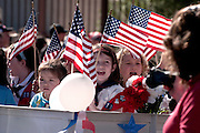 Participants march in the Veterans Day Parade, which honors American military veterans, in Tucson, Arizona, USA.