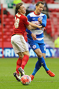 Nottingham Forest midfielder Ben Osborn and Queens Park Rangers midfielder Daniel Tozser come together during The FA Cup third round match between Nottingham Forest and Queens Park Rangers at the City Ground, Nottingham, England on 9 January 2016. Photo by Aaron Lupton.
