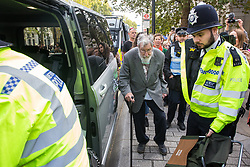 London, UK. 9 October, 2019. John Lynes, a 91-year-old climate activist from Extinction Rebellion is arrested by police officers using Section 14 of the Public Order Act 1986 after blocking Whitehall on the third day of International Rebellion protests to demand a government declaration of a climate and ecological emergency, a commitment to halting biodiversity loss and net zero carbon emissions by 2025 and for the government to create and be led by the decisions of a Citizens' Assembly on climate and ecological justice.