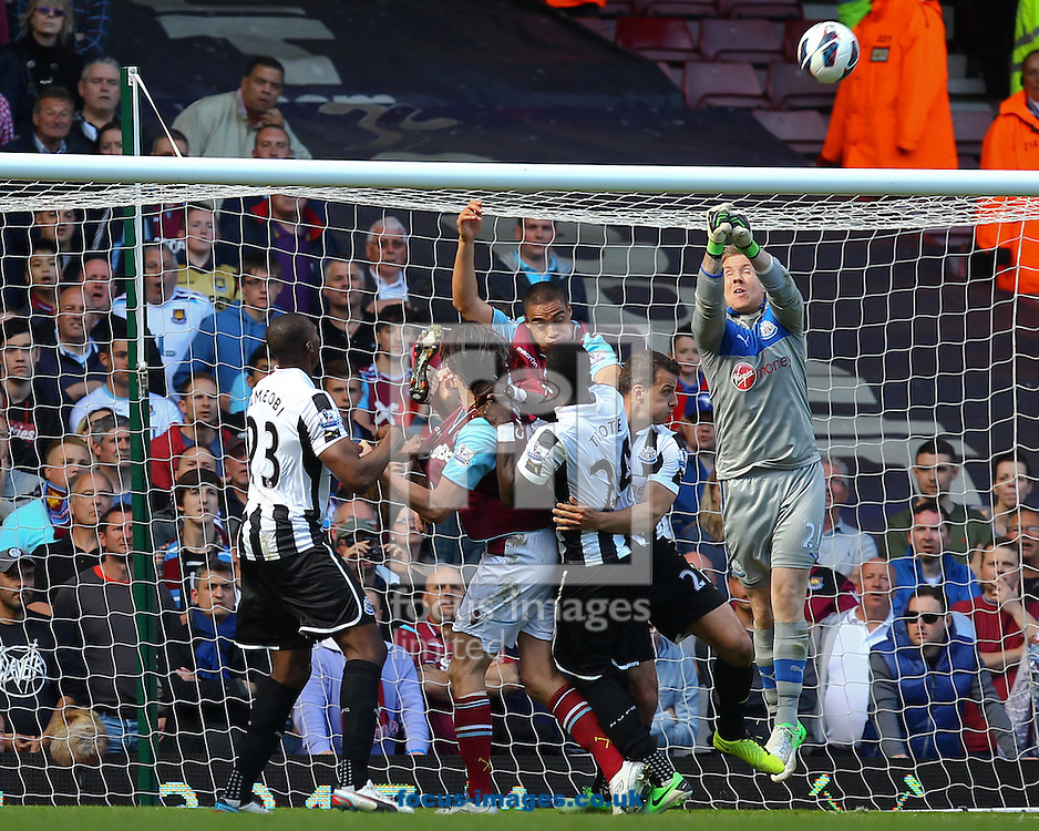 Picture by John Rainford/Focus Images Ltd +44 7506 538356.04/05/2013.West Ham United players are beaten to a high ball by Rob Elliot of Newcastle United during the Barclays Premier League match at the Boleyn Ground, London.