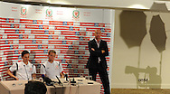 Wales players Joe Allen (l) and Chris Gunter (r) flanked by Welsh team media officer Ian Gwyn Hughes face the cameras.Wales football players media session at St.Davids Hotel in Cardiff on Tuesday 4th Sept 2012, the Welsh players talk about their forthcoming World cup qualifier against Belgium on Friday 8th Sept.  pic by  Andrew Orchard, Andrew Orchard sports photography,