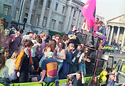 Ravers dancing on top of a truck at the First Criminal Justice March. Trafalgar Square,London,UK, 1st of May 1994