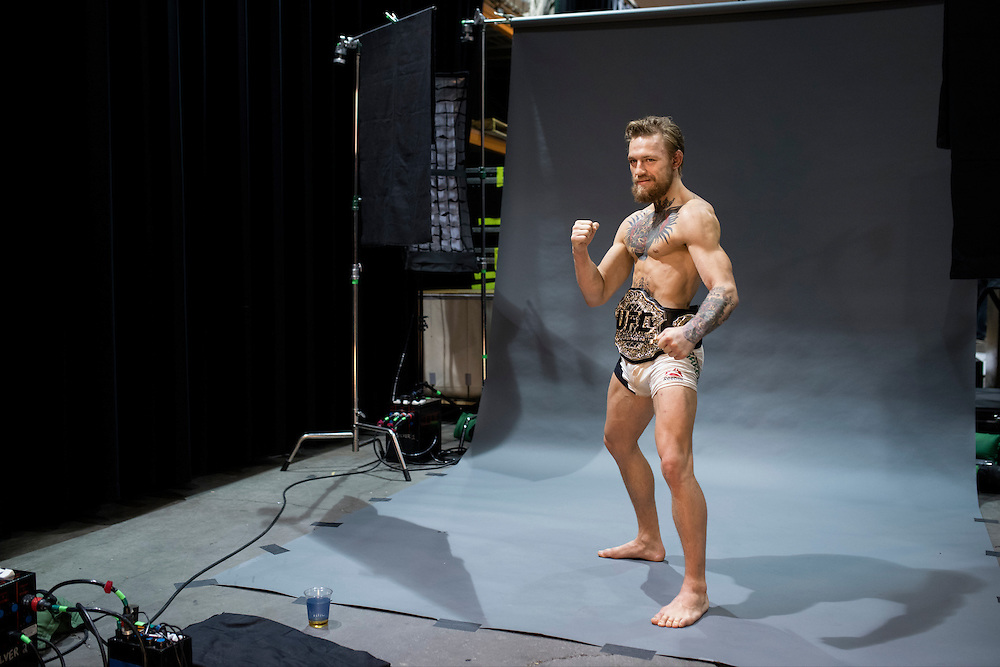 Conor McGregor poses for a photo after defeating Chad Mendes for the interim UFC featherweight title during UFC 189 at the MGM Grand Garden Arena in Las Vegas, Nevada on July 11, 2015. (Cooper Neill)
