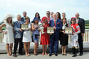 Amy Figueroa, center left, of Longines, presents watches from the Longines Master collection to the winning team after their horse Celestine wins the 23rd running of the Longines Just a Game Stakes, Saturday, June 11, 2016, at Belmont Park in Elmont, NY. Longines, the Swiss watchmaker known for its elegant timepieces, is the Official Watch and Timekeeper of the 148th running of the Belmont Stakes.(Diane Bondareff/AP Images for Longines)