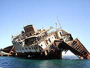 Where Cargo Ships Go To Die <br /> <br /> Muynak is a city in northern Karakalpakstan in western Uzbekistan. Home to only a few thousand residents at most, Muynak's population has been declining precipitously since the 1980s due to the recession of the Aral Sea.<br /> <br /> Once a bustling fishing community, Muynak is now a shadow of its former self, dozens of miles from the rapidly receding shoreline of the Aral Sea. Fishing had always been part of the economy of the region, and Muynak became a center of industrial fishing and canning. A regional agricultural monoculture dominated by cotton production which diverts water from tributary rivers of the sea into irrigation, and severe pollution caused by agricultural chemical runoff, are causing the sea to evaporate and the water that remains is highly saline and very toxic, causing the ecological disaster which is inevitably destroying the sea and killing the residents of the towns in its vicinity, including Muynak.<br /> <br /> Muynak is now home to a incongruous armada of rusting hulks that once made up the proud fishing fleet during the Soviet era. Poisonous dust storms kicked up by strong winds across the dried and polluted seabed give rise to a multitude of chronic and acute illnesses among the few residents, weather unmoderated by the sea now buffets the town with hotter-than-normal summers and colder-than-normal winters.<br /> <br /> The Aral Sea was once the world's fourth-largest saline body of water, it has been steadily shrinking since the 1960s, after the rivers that fed it were diverted by Soviet Union irrigation projects. By 2004, the sea had shrunk to 25% of its original surface area, and a nearly fivefold increase in salinity had killed most of its natural flora and fauna. By 2007 it had declined to 10% of its original size, splitting into three separate lakes, two of which are too salty to support fish. The once prosperous fishing industry has been virtually destroyed, and former fishing towns along the original shores have become ship graveyards.