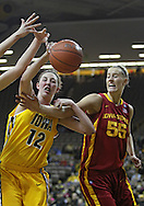 December 09 2010: Iowa center Morgan Johnson (12) battles for the ball with Iowa St. center Anna Prins (55) during the first half of their NCAA basketball game at Carver-Hawkeye Arena in Iowa City, Iowa on December 9, 2010. Iowa defeated Iowa State 62-40 in the Hy-Vee Cy-Hawk Series rivalry game.