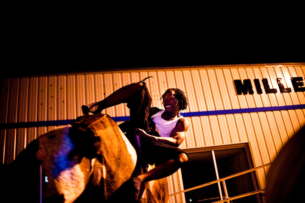 Dre rides a mechanical bull outside Derby Bar in Valentine, NE June 15, 2013. Photo by Lauren Justice