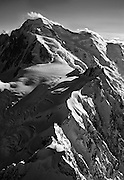 An aerial view of the summit of Mont Blanc, the top station of the telepherique of the Aiguille du Midi, and the Vallee Blanche above the Chamonix Valley, France.