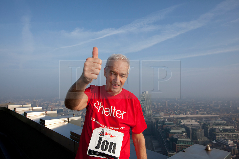 © Licensed to London News Pictures. 01/03/2012. LONDON, UK. Broadcaster Jon Snow celebrates reaching the top of Tower 24 at Shelter's Vertical Rush, the UK's biggest tower running event in the City of London.  Today (01/03/12) a host of celebrities joined 1,200 people to run up the 920 steps of Tower 42, raising £250,000 for housing charity Shelter. Now in its fourth year, the award-winning Vertical Rush will once again take place at London's original skyscraper, Tower 42. Photo credit: Matt Cetti-Roberts/LNP© Licensed to London News Pictures. 01/03/2012. LONDON, UK. CAPTION HERE. Photo credit: Matt Cetti-Roberts/LNP