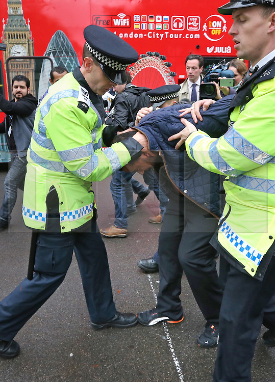 © Licensed to London News Pictures. 05/11/2015. London, UK. A man is taken away by police as protests are held near Downing Street during the visit of Egyptian President Sisi. Photo credit: Peter Macdiarmid/LNP