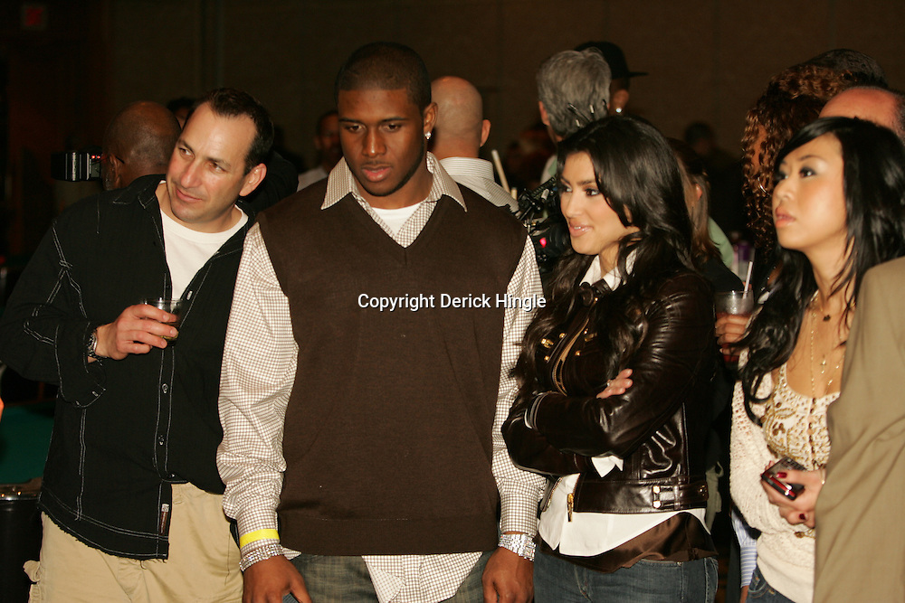Reggie Bush and Kim Kardashian at the Big Easy Billiard' Bash a celebrity pool tournament and party hosted by NFL Superstar Reggie Bush and NBA Superstar (SHAQ) Shaquille O'Neal at the Hilton Riverside Hotel in New Orleans, Louisiana on February 15th 2008.