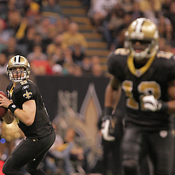 2008 December, 28: New Orleans Saints quarterback Drew Brees (9) looks to pass downfield during a week 17 game between NFC South divisional rivals the Carolina Panthers and the New Orleans Saints at the Louisiana Superdome in New Orleans, LA.