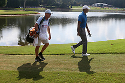 September 22, 2018 - Atlanta, Georgia, United States - Tiger Woods (R) and his caddie Joe LaCava walk the 8th fairway during the third round of the 2018 TOUR Championship. (Credit Image: © Debby Wong/ZUMA Wire)