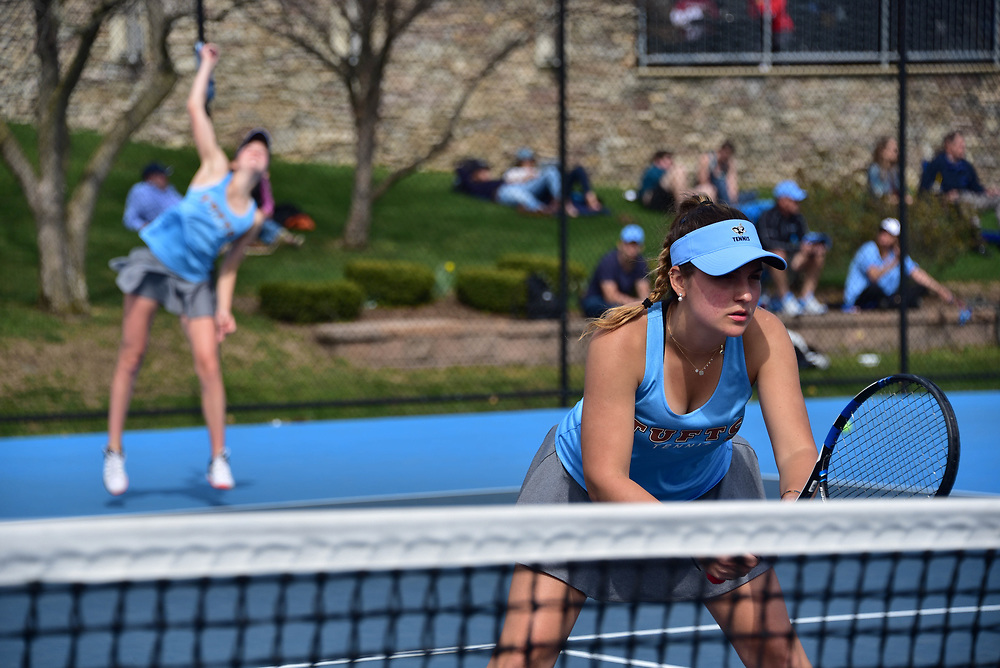 15/04/2017 - Medford, MA - Junior Lauren Louks serves the ball while Sophomore Mina Karamercan wait in position during Tufts' 6-3 win against Wesleyan on April 15.(Seohyun Shim / The Tufts Daily)