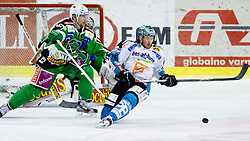 Rob Hisey (EHC Liwest Linz, #26) vs Ales Music (HDD Tilia Olimpija, #16) and Matija Pintaric (HDD Tilia Olimpija, #69) during ice-hockey match between HDD Tilia Olimpija and EHC Liwest Black Wings Linz at fourth match in Semifinal  of EBEL league, on March 13, 2012 at Hala Tivoli, Ljubljana, Slovenia. (Photo By Matic Klansek Velej / Sportida)