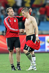 07.07.2010, Moses Mabhida Stadium, Durban, SOUTH AFRICA, Deutschland ( GER ) vs Spanien ( ESP ) im Bild Bastian Schweinsteiger of Germany is consoled after the final whistle mit Koepke, Torwarttrainer Foto ©  nph /  Kokenge / SPORTIDA PHOTO AGENCY
