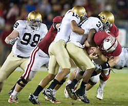 November 28, 2009; Stanford, CA, USA;  Stanford Cardinal running back Toby Gerhart (7) is tackled by Notre Dame Fighting Irish safety Sergio Brown (31) and cornerback Robert Blanton (12) during the second quarter at Stanford Stadium.  Stanford defeated Notre Dame 45-38.