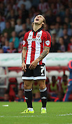 Sam Saunders (Brentford midfielder) cant believe he missed an opportunity during the Sky Bet Championship match between Brentford and Reading at Griffin Park, London, England on 29 August 2015. Photo by Matthew Redman.