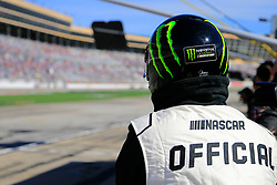 February 24, 2019 - Hampton, GA, U.S. - HAMPTON, GA - FEBRUARY 24: A NASCAR Official watches over the pit area during the 60th annual running of the Folds of Honor Quik Trip 500 Monster Energy NASCAR Cup Series race on February 24, 2019 at the Atlanta Motor Speedway in Hampton, GA.  (Photo by David J. Griffin/Icon Sportswire) (Credit Image: © David J. Griffin/Icon SMI via ZUMA Press)