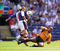 Photo. Jed Wee<br /> Blackburn Rovers v Wolverhampton Wanderers, FA Barclaycard Premiership, Ewood Park, Blackburn. 16/08/2003.<br /> Blackburn's Tugay (L) tries to get out of the way of a sliding Paul Ince tackle.