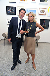 ELLIOTT MACDONALD and IWONA BLAZWICK Director of the gallery at a private view of work by artist Elizabeth Peyton 'Live Forever' held at the Whitechapel Gallery, 77-82 Whitechapel High Street, London E1 on 7th July 2009.
