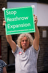 © London News pictures...  01/07/2015. Harmondsworth, UK. Stop Heathrow Expansion NEIL KEVEREN holding a Stop Heathrow Expansion sign in Harmondsworth in West London. Harmondsworth is due to be demolished to make way for a third runway at Heathrow Airport if plans go ahead. The airports commission today (Weds) gave it's backing for the £18.6bn plan for a third runway at Heathrow. Photo credit: Ben Cawthra/LNP