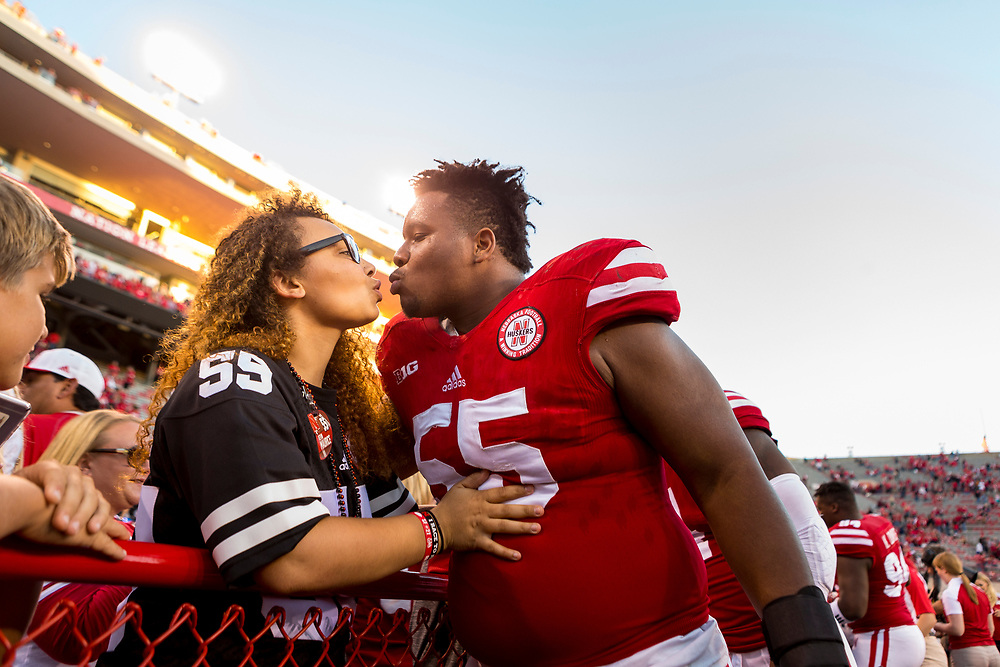 Kevin Maurice gets a kiss from Nataleigh Maurice during Nebraska's game vs. Purdue at Memorial Stadium in Lincoln, Neb. on Oct. 22, 2016. Photo by Aaron Babcock, Hail Varsity