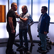 MIAMI, FL MARCH 20, 2018: Telemundo Network soccer commentator Andres Cantor, left, famous for his goal call,  gets a microphone between rehearsals in the network's new state of the art building. He and a team of commentators were rehearsing and getting acquainted with the facilities. <br /> (Photo by Angel Valentin-For The Washington Post )