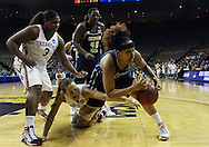 24 MARCH 2009: Oklahoma guard Whitney Hand (25) and Georgia Tech guard/forward Iasia Hemingway (34) battle for a lose ball as Oklahoma center Courtney Paris (3) and Georgia Tech center Sasha Goodlett (45) look on during an NCAA Women's Tournament basketball game Tuesday, March 24, 2009, at Carver-Hawkeye Arena in Iowa City, Iowa. Oklahoma defeated Georgia Tech 69-50.