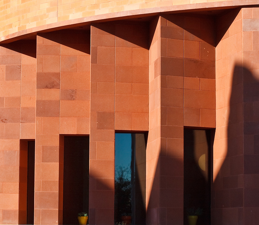 Folded walls are juxtaposed against curved brick facade at FW Science & History Museum.