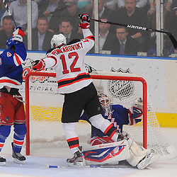 May 16, 2012: New Jersey Devils left wing Alexei Ponikarovsky (12) slams New York Rangers goalie Henrik Lundqvist (30) into his net during third period action in game 2 of the NHL Eastern Conference Finals between the New Jersey Devils and New York Rangers at Madison Square Garden in New York, N.Y. The Devils defeated the Rangers 3-2.