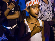 23 OCTOBER 2015 - YANGON, MYANMAR:  A Shia boy pounds his chest during Ashura observances at Mogul Mosque in Yangon. Ashura commemorates the death of Hussein ibn Ali, the grandson of the Prophet Muhammed, in the 7th century. Hussein ibn Ali is considered by Shia Muslims to be the third imam and the rightful successor of Muhammed. He was killed at the Battle of Karbala in 610 CE on the 10th day of Muharram, the first month of the Islamic calendar. According to Myanmar government statistics, only about 4% of the population is Muslim. Many Muslims have fled Myanmar in recent years because of violence directed against Burmese Muslims by Buddhist nationalists.    PHOTO BY JACK KURTZ