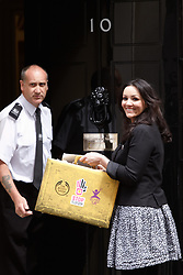 © licensed to London News Pictures. LONDON, UK  12/05/2011. Actress Martine McCutcheon (R) hands over a petition, signed by nearly 750,000 Britons, to 10 Downing Street calling on the Government to provide greater care and protection for child victims of trafficking. Please see special instructions for usage rates. Photo credit should read CLIFF HIDE/LNP