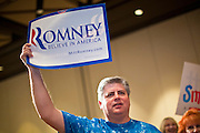 28 FEBRUARY 2012 - PHOENIX, AZ:     Mitt Romney supporter NICK HUNTINGTON, from Mesa, AZ, cheers when early results showing Mitt Romney leading over Rick Santorum come in to a Phoenix, AZ, hotel ballroom. Several hundred Romney supporters crowded into a ballroom in a Phoenix hotel to watch primary results from Michigan and Arizona. Romney won the night, scoring a tight win in the Michigan Republican Presidential primary and a comfortable win in the Arizona Republican Presidential primary.    PHOTO BY JACK KURTZ
